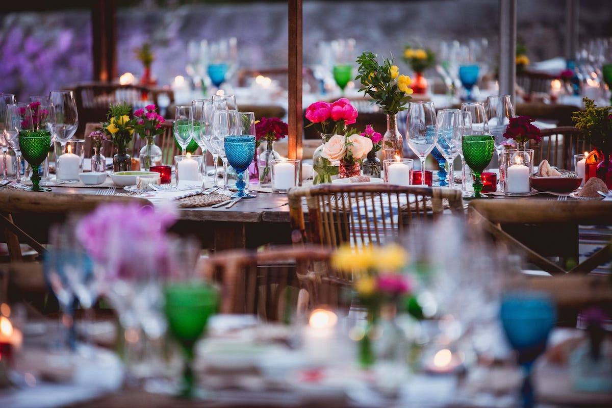 decoration for wedding in Mallorca with lighting, flowers and candles on a wooden table