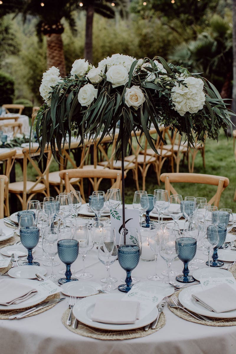 wedding setting table with flowers centerpieces, bouquet and decoration for wedding reception in Mallorca